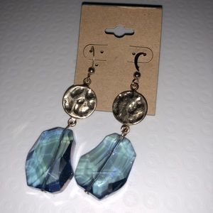 Gold tone hammered earrings with blue stone